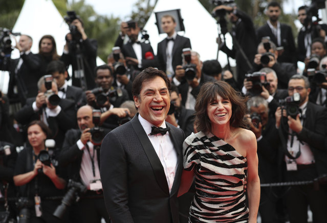 "Actors Javier Bardem, left, and Charlotte Gainsbourg pose for photographers upon arrival at the opening ceremony and the premiere of the film ""The Dead Don't Die"" at the 72nd international film festival, Cannes, southern France, Tuesday, May 14, 2019. (Photo by Petros Giannakouris/AP Photo)"