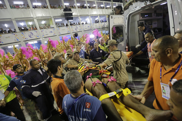 A performer from the Unidos da Tijuca samba school is carried into an ambulance after a float collapsed during Carnival celebrations at the Sambadrome in Rio de Janeiro, Brazil, Tuesday, February 28, 2017. (Photo by Silvia Izquierdo/AP Photo)