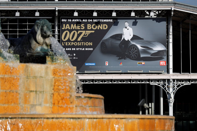 """A poster to announce the exhibition """"The Designing 007: Fifty Years of Bond Style"""" is seen on the facade of the Grande Halle de la Villette in Paris, France, April 13, 2016. (Photo by Benoit Tessier/Reuters)"""