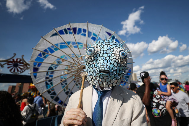 People in costume march during the 37th Annual Coney Island Mermaid Parade in Coney Island in New York, United States on June 22, 2019. The annual parade, which is attended by people in outlandish costumes, marks the beginning of the summer season in Coney Island. (Photo by Atilgan Ozdil/Anadolu Agency/Getty Images)