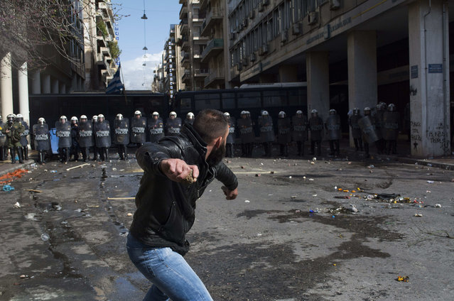 Farmers clash with riot policemen during a protest outside the Greek Agriculture Ministry on March 8, 2017 in Athens, Greece. (Photo by Nikolas Georgiou/ZUMA Wire/Rex Features/Shutterstock)