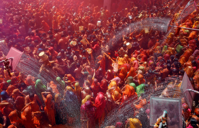"""Hindu devotees take part in """"Huranga"""", a game played between men and women a day after Holi, at Dauji temple near Mathura, March 14, 2017. (Photo by Cathal McNaughton/Reuters)"""