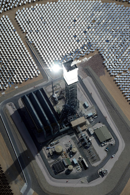 The Ivanpah Solar Electric Generating System is seen in an aerial view on February 20, 2014 in the Mojave Desert in California near Primm, Nevada.(Photo by Ethan Miller/Getty Images)