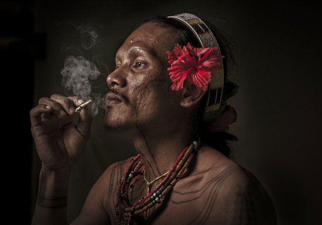 Portrait of a Mentawai, the native people of the Mentawai Islands. They live a semi-nomadic hunter-gatherer lifestyle in coastal and rainforest environments. Pulau Siberut, Mentawai Islands, Indonesia. (Photo by Mohd Irman Ismail/Smithsonian.com)