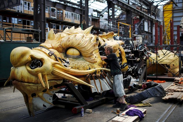 "A man works on ""Long Ma"", a creation by La Machine production company, during a media visit to ""A Journey to Nantes"" (Le Voyage a Nantes) art festival in Nantes, France, June 30, 2015. The art festival will run from July 3 to August 30. (Photo by Stephane Mahe/Reuters)"