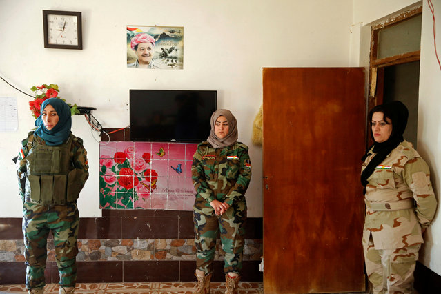 Female Peshmerga fighters stand at their site near the frontline of the fight against Islamic State militants in Nawaran near Mosul, Iraq, April 20, 2016. (Photo by Ahmed Jadallah/Reuters)