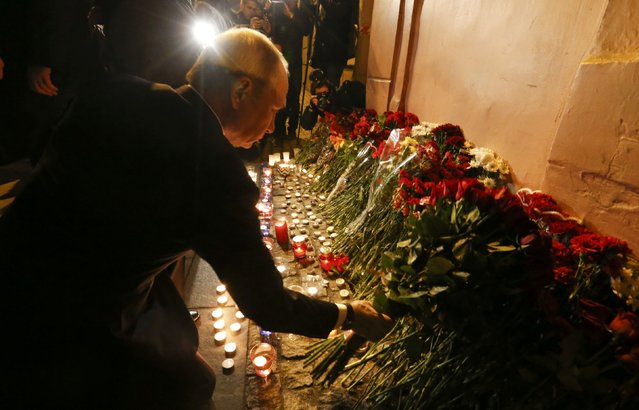 Russian president Vladimir Putin puts flowers down outside Tekhnologicheskiy Institut metro station in St. Petersburg, Russia, April 3, 2017. (Photo by Grigory Dukor/Reuters)