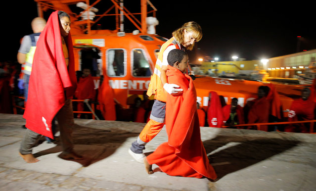 Migrants, intercepted off the coast in the Mediterranean Sea, disembark from a rescue boat at the port of Malaga, southern Spain, September 2, 2019. (Photo by Jon Nazca/Reuters)