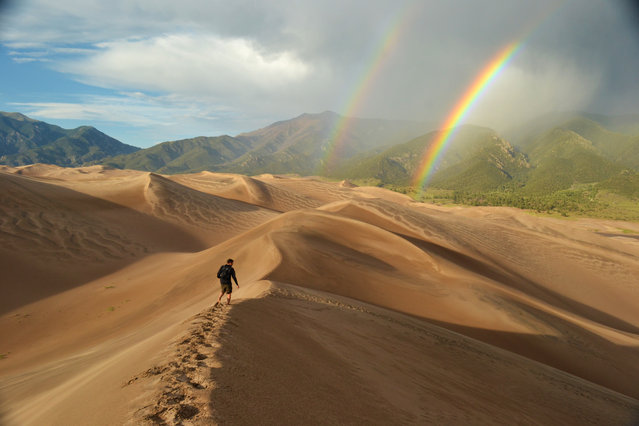 Winner of the National Park Foundation's photo contest; Honorable Mention: Adventure. Great Sand Dunes National Park and Preserve, Colorado. Hiking down from High Dune, the second tallest dune in North America, after being caught seriously off guard by a sandstorm near the summit. (Photo by Eric Magayne)