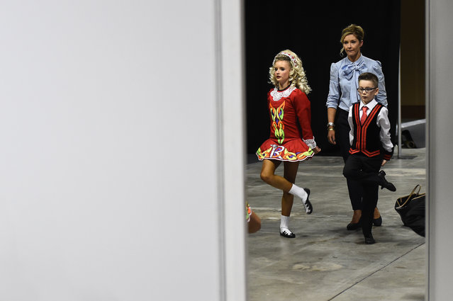 Dancers warm up backstage before performing during the World Irish Dancing Championships in Dublin, Ireland on April 11, 2017. (Photo by Clodagh Kilcoyne/Reuters)