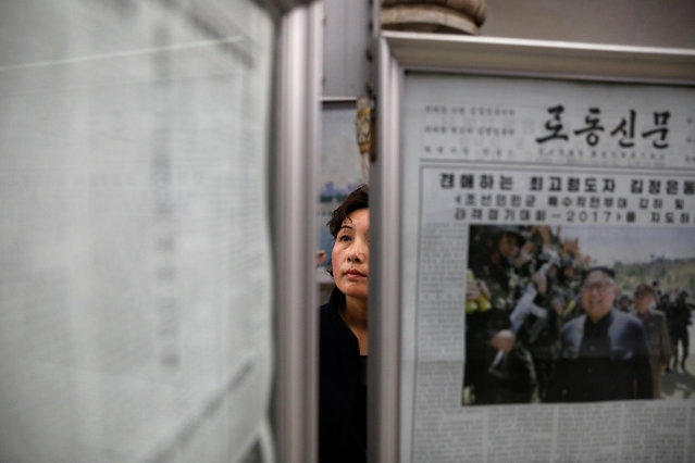 A woman reads newspapers displayed at a subway station visited by foreign reporters, in central Pyongyang, North Korea on April 14, 2017. (Photo by Damir Sagolj/Reuters)