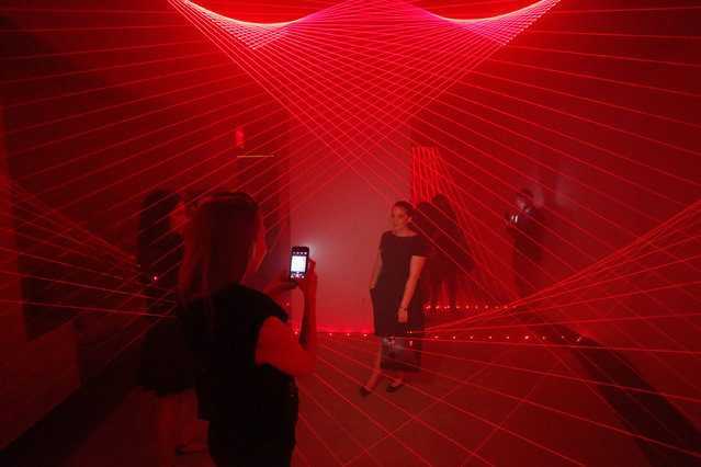 """Guests experience """"Bold Notion: Art of Innovation"""", an immersive exhibition of light and space curated by artist, Matthew Schreiber, presented by Audi as part of the CORE: club's Bold Notion series at the CORE: club on May 12, 2016 in New York City. (Photo by Brian Ach/Getty Images for Audi)"""