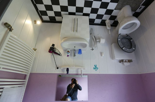 """General view of the bathroom inside the """"Crazy House"""", which is completely built upside-down, in the village of Affoldern near the Edersee lake, May 7, 2014. Three friends came up with the idea to build the tourist attraction, which cost about 200,000 euros and took some six weeks to complete. (Photo by Kai Pfaffenbach/Reuters)"""