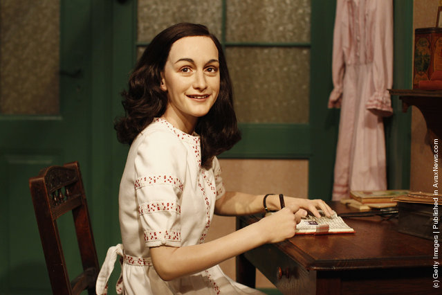 A wax figure of Anne Frank and their hideout reconstruction is unveiled at Madame Tussauds in Berlin