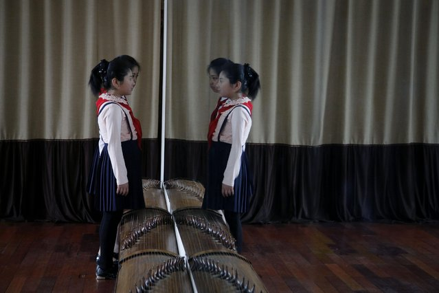 School girls study their own expressions in the mirror during a singing class, Thursday, May 7, 2015, in Pyongyang, North Korea. (Photo by Wong Maye-E/AP Photo)