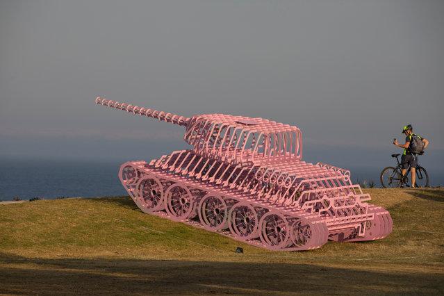 "Sculpture ""Pinktank Wrecked"" by David Černý is seen at Hunter Park, Bondi Beach, Australia on October 24, 2019. (Photo by Jessica Hromas/The Guardian)"