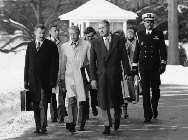 In this February 14, 1979 file photo, President Jimmy Carter, flanked by Secretary of State Cyrus, right, and his advisor on foreign policy, Zbigniew Brzezinski, left, walk toward a waiting helicopter to fly to the nearby Andrews Air Force Base, Md. Brzezinski, the national security adviser to President Carter, has died at age 89. His death was announced on social media Friday night, May 26, 2017, by his daughter, MSNBC host Mika Brzezinski.  (Photo by Bob Daugherty/AP Photo)