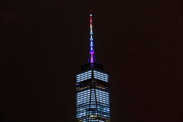 The spire of One World Trade Center is lit in rainbow colors to honor the victims of the Orlando shooting massacre at the Pulse nightclub, in the Manhattan borough of New York, U.S., June 13, 2016. (Photo by Andrew Kelly/Reuters)