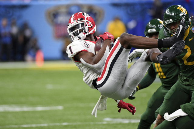 Georgia wide receiver George Pickens (1) is upended by Baylor linebacker Blake Lynch (2) during the first half of the Sugar Bowl NCAA college football game in New Orleans, Wednesday, January 1, 2020. (Photo by Bill Feig/AP Photo)