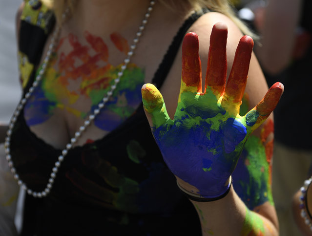 A woman sports a rainbow painted hand at the annual PrideFest celebration at Civic Center Park June 18, 2016. (Photo by Andy Cross/The Denver Post)