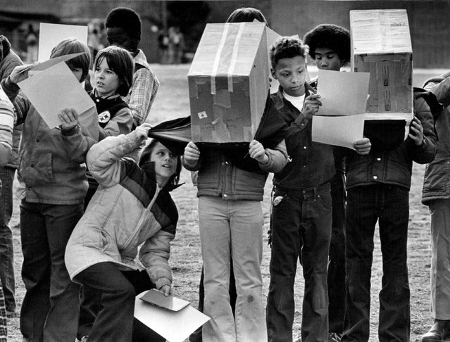 Many Denverites took a guarded look at the sun – or at the sun's image – in a partial, 88 percent eclipse in 1979. Denver Public School teachers took advantage of student interest in the astronomical phenomenon (there won't be another until the year 2017) to carry out some scientific classroom projects. William Wilkin, principal at Stephen Knight Elementary School, said all 380 pupils left their classrooms to see the eclipse from the vantage point of the playground. Many youngsters made viewing boxes to watch the eclipse by projection. (Photo by Ernie Leyba/The Denver Post)