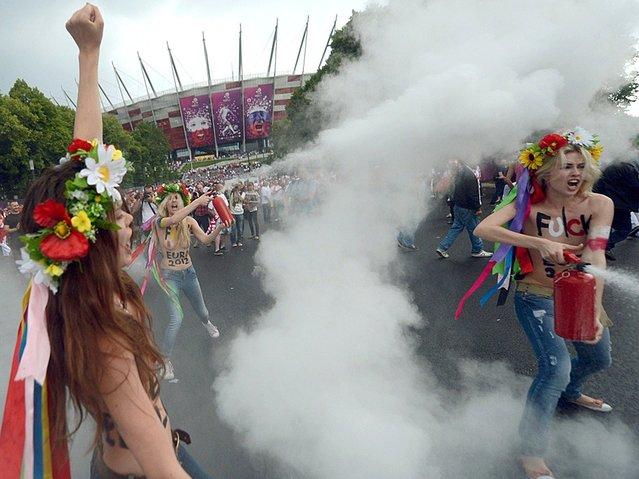FEMEN Activists Strip In Protest Against EURO 2012