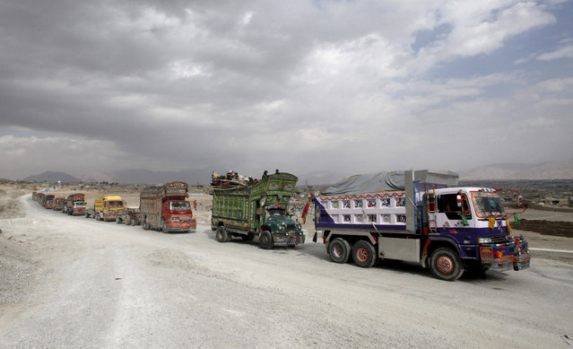 Decorated trucks travel on the main highway outside Quetta, Pakistan November 22, 2015. (Photo by Naseer Ahmed/Reuters)