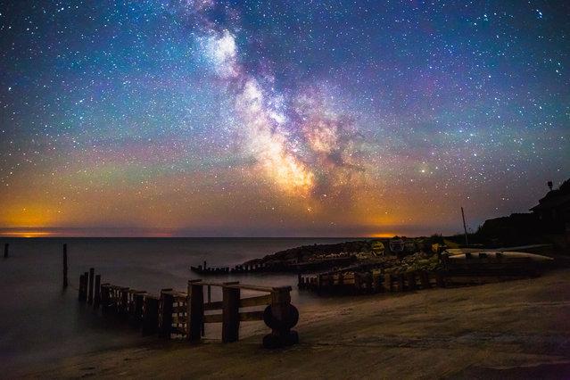 The Milky Way behind Castle Haven, a small harbour in Nilton on July 2, 2014, in Isle of Wight, UK. (Photo by Chad Powell/Barcroft Media)