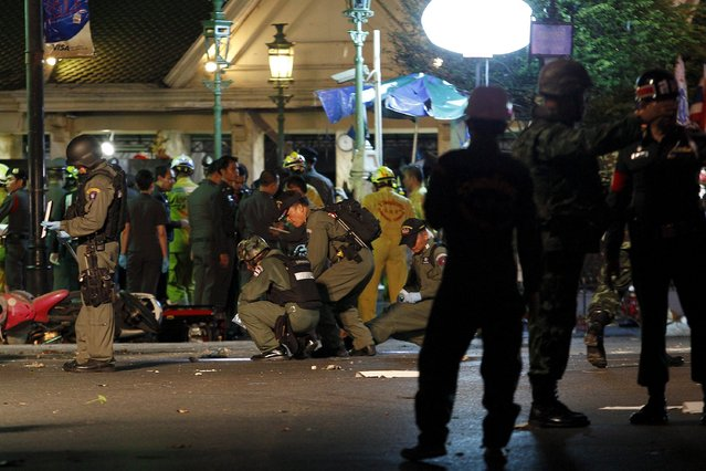 Security forces and emergency workers gather at the scene of a blast in central Bangkok August 17, 2015. (Photo by Kerek Wongsa/Reuters)