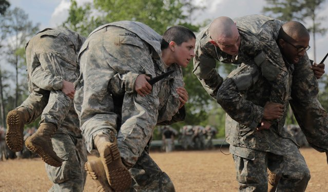 Then U.S. Army First Lieutenant Kirsten Griest (C) and fellow soldiers participate in combatives training during the Ranger Course on Fort Benning, Georgia, in this handout photograph taken on April 20, 2015 and obtained on August 20, 2015. When Griest and another woman completed the daunting U.S. Army Ranger school this week they helped end questions about whether women can serve as combat leaders, as the Pentagon is poised to open new roles, including elite Navy SEALs, to women in coming months. (Photo by Spc. Nikayla Shodeen/Reuters/U.S. Army)