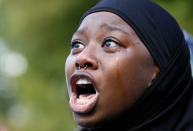 A woman protests the shooting death of Alton Sterling near the headquarters of the Baton Rouge Police Department in Baton Rouge, Louisiana, U.S. July 9, 2016. (Photo by Jonathan Bachman/Reuters)