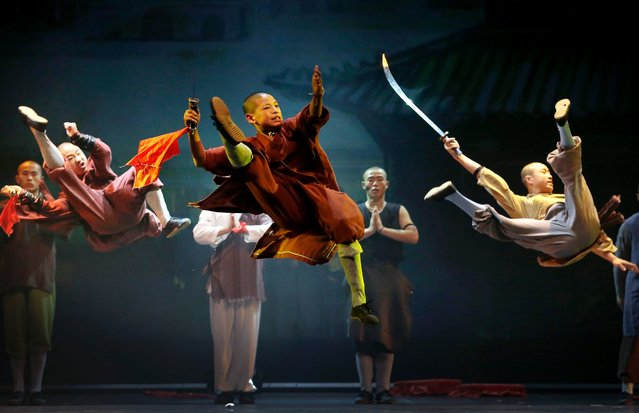 """Shaolin monks, who are part of a 20-member cast, perform during a media preview of their new show """"Shaolin"""", July 13, 2016, in Singapore. (Photo by Wong Maye-E/AP Photo)"""