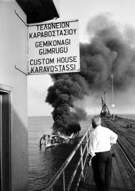 A Greek Cypriot patrol boat burns fiercely, after an attack by Turkish Air Force jets, off Xeros, Cyprus, on July 8, 1964. Six of its crew were reported to have been killed and 15 others wounded. (Photo by AP Photo)