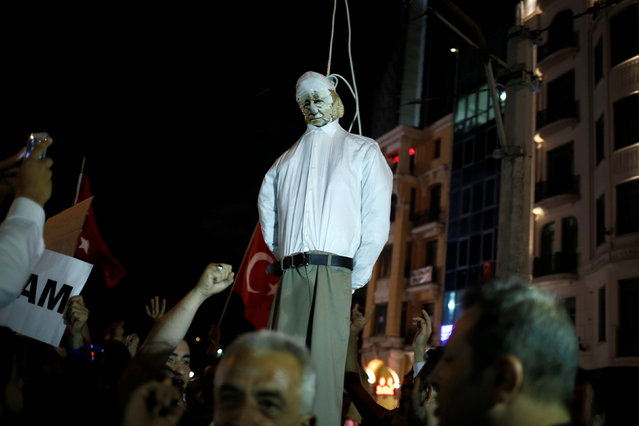 Supporters of Turkish President Tayyip Erdogan hold an effigy of U.S.-based cleric Fethullah Gulen hanged by a noose, during a pro-government demonstration on Taksim Square in Istanbul, Turkey, July 18, 2016. (Photo by Alkis Konstantinidis/Reuters)