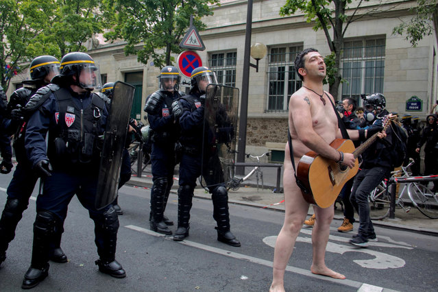 A naked protester sings during the labor reform protest in Paris, France September 12, 2017 in this picture obtained from social media. (Photo by David A. Cordova/Reuters/Instagram)