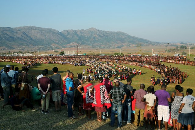 Locals and visitors watch Maidens as they gather for the the last day of the Reed Dance at Ludzidzini Royal Palace in Swaziland, August 31, 2015. (Photo by Siphiwe Sibeko/Reuters)