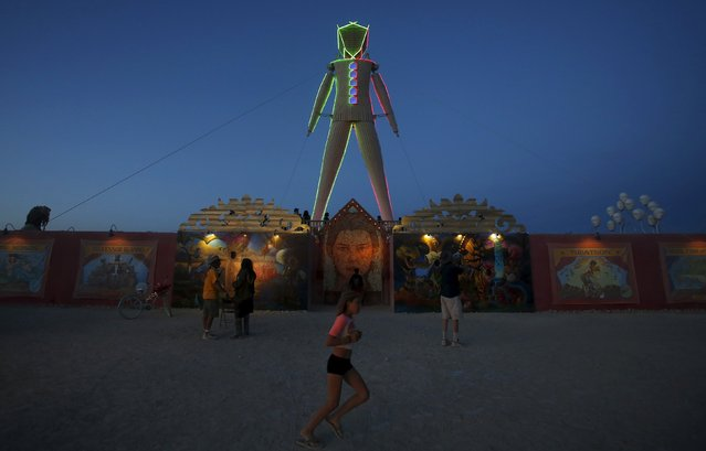 "A view of The Man during the Burning Man 2015 ""Carnival of Mirrors"" arts and music festival in the Black Rock Desert of Nevada, September 1, 2015. (Photo by Jim Urquhart/Reuters)"