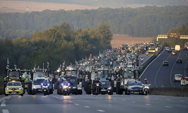 French farmers from western France regions drive their tractors on the A10 motorway, outside Paris, September 3, 2015. (Photo by Jacky Naegelen/Reuters)