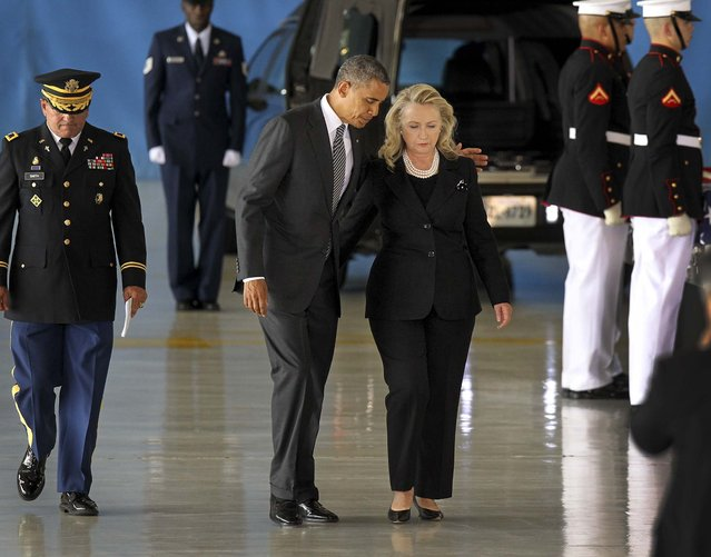 President Barack Obama and Secretary of State Hillary Clinton walk away from the podium during the Transfer of Remains Ceremony marking the return to the United States of the remains of the four Americans killed this week in Benghazi, Libya, at Joint Base Andrews. (Photo by Molly Riley/Polaris via Abaca Press/MCT)