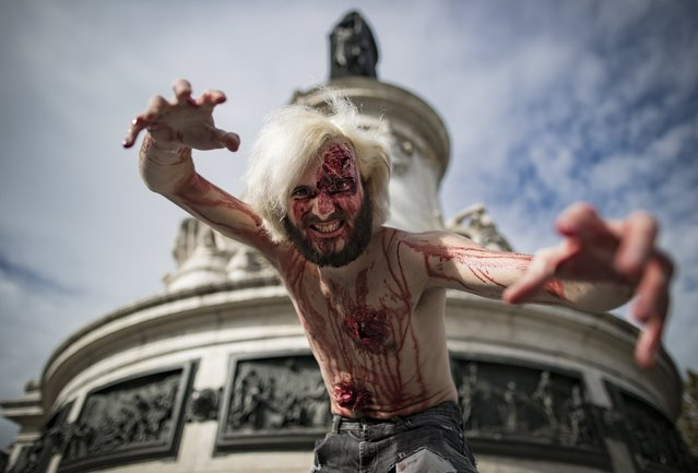 Participants in costume take part in a walk for World Zombie Day 2017, on Place de la Republique in Paris, France, 07 October 2017. (Photo by Ian Langsdon/EPA/EFE)