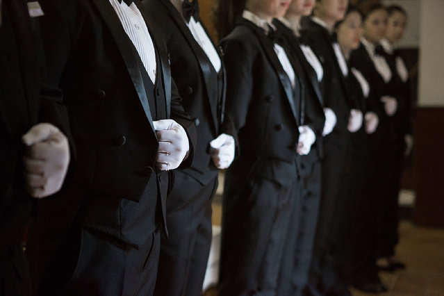 Butlery students stand for inspection once they arrive in the morning at The International Butler Academy China on September 16, 2014 in Chengdu, China. (Photo by Taylor Weidman/Getty Images)