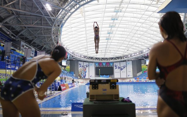 A competitor dives from a 1m springboard during a diving practice session at the Munhak Park Tae-hwan Aquatics Center during the 17th Asian Games in Incheon September 30, 2014. (Photo by Tim Wimborne/Reuters)