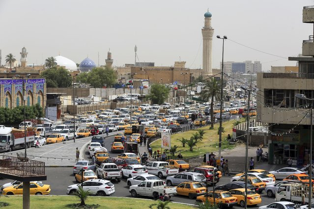 Taxies and vehicles are seen after vehicles with odd and even numbered plates were allowed to hit the road by the Iraqi General Directorate of Traffic as part of the novel coronavirus (COVID-19) pandemic measures in Baghdad, Iraq on May 05, 2020. Vehicles with odd-numbered plates were allowed to odd numbered days and even-numbered plates were allowed to even-numbered days. (Photo by Murtadha Al-Sudani/Anadolu Agency via Getty Images)