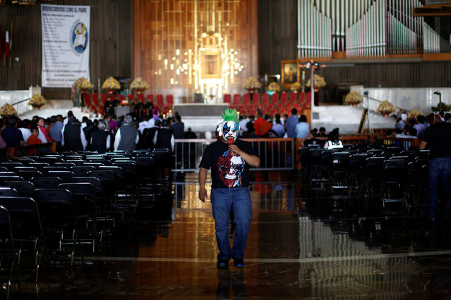 Mexican wrestler known as Mini Psycho walks inside the Basilica of Our Lady Guadalupe during the annual pilgrimage in Mexico City, Mexico August 25, 2016. (Photo by Carlos Jasso/Reuters)