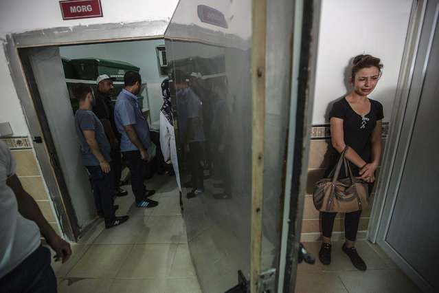 A woman cries at the morgue as she waits for the coffin of her relative, killed during last night's attack on a wedding party that left 50 dead in Gaziantep in southeastern Turkey near the Syrian border on August 21, 2016. At least 50 people were killed when a suspected suicide bomber linked to Islamic State jihadists attacked a wedding thronged with guests, officials said on August 21. (Photo by Ahmed Deep/AFP Photo)
