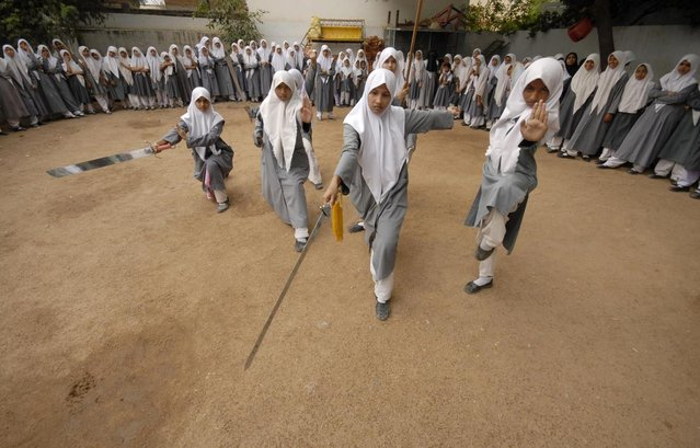 Muslim schoolgirls from St. Maaz high school practise Chinese wushu martial arts inside the school compound in Hyderabad July 8, 2008. (Photo by Krishnendu Halder/Reuters)