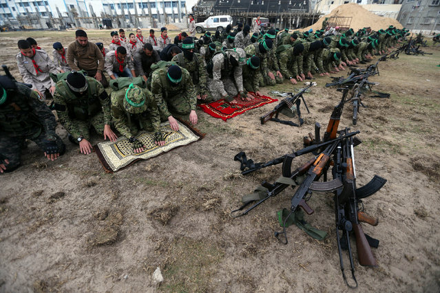 Palestinian Hamas militants pray before the start of a military show ahead of the 30th anniversary of Hamas' founding, in Khan Younis in the southern Gaza Strip, December 5, 2017. (Photo by Ibraheem Abu Mustafa/Reuters)