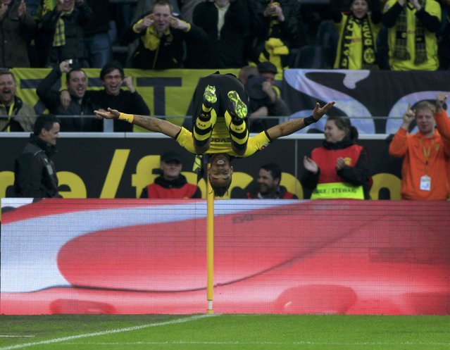 Borussia Dortmund's Pierre-Emerick Aubameyang celebrates scoring a second goal against Darmstadt 98 during the Bundesliga first division soccer match in Dortmund, Germany September 27, 2015. (Photo by Ina Fassbender/Reuters)