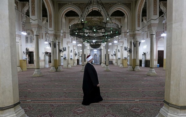 An Egyptian sheikh walks before the first Fajr prayer inside the Salah El-Din Mosque after months of closure, after an outbreak of Corona Virus-19, in Cairo, Egypt on June 27, 2020. (Photo by Mohamed Abd El Ghany/Reuters)