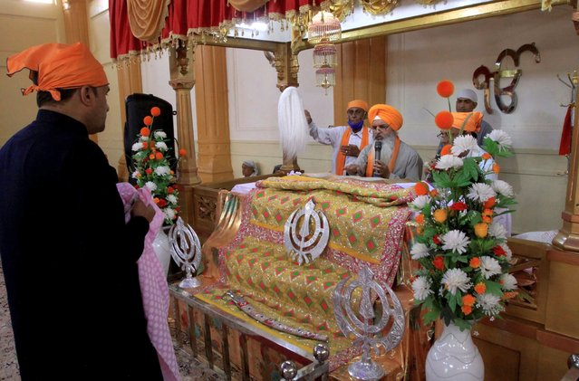 People of the Sikh community take part in worship at the Gurudawara Sri Guru Singh Sabha temple in Quetta, Pakistan, Thursday, July 23, 2020. The 200-year-old Sikh temple that served as a school for Muslim girls for seven decades was returned to the Sikh community in the city of Quetta, enabling them to worship there for the first time in 73 years, officials said Thursday. (Photo by Arshad Butt/AP Photo)
